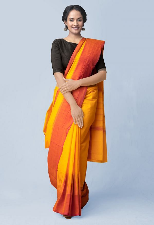 Online Shopping for Yellow Pure Handloom Kanchi Cotton Saree with Batik Prints from Rajasthan at Unnatisilks.comIndia