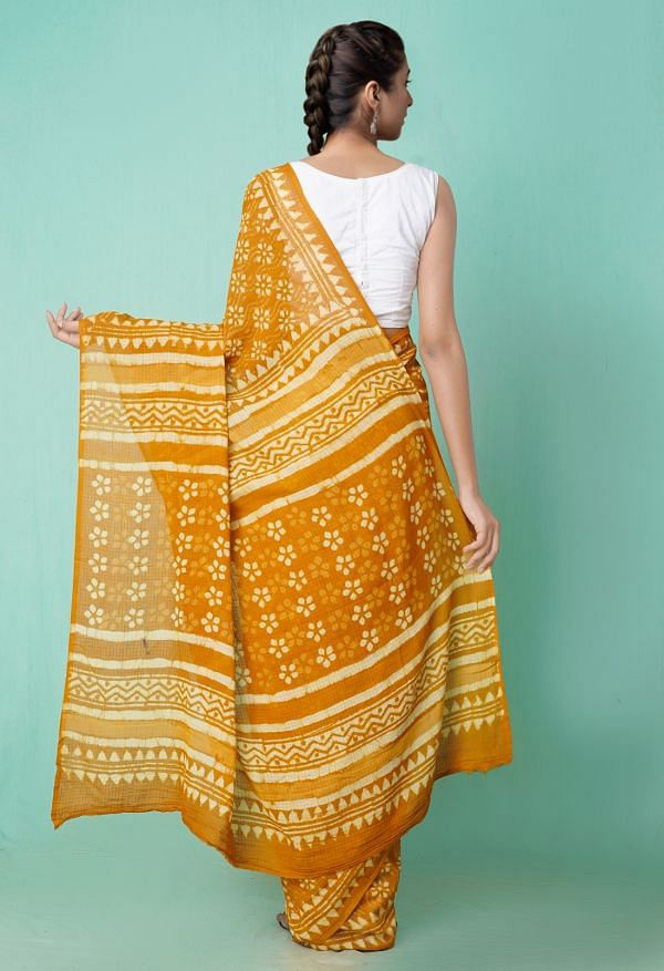 Online Shopping for Orange Pure Preet Dabu Mulmul Cotton Saree with Bagru from Rajasthan at Unnatisilks.comIndia