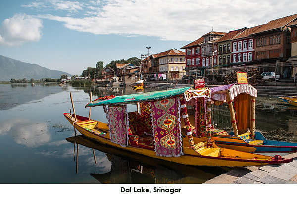 Kashmir's Dal lake is vast. The tiny boats called Shikaras to larger House boats are premiere attractions here.